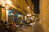 outdoor cafe, young people sitting outside, old town, Valencia, Spain