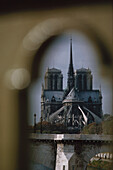 View of Notre Dame cathedral through an arch, Paris, France
