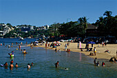 The beach and beach life at Playa Honda, Acapulco, Mexico, America