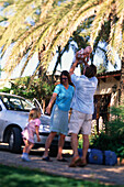 Family travelling, on holiday, car in the background, Holiday Appartment, Finca, Mallorca, Balearic Islands, Spain