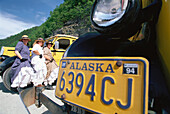 Three female drivers of tour buses in traditional dress, Skagway, Alaska, USA