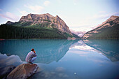 Man enjoying views at Lake Louise, Rocky Mountains, Alberta, Canada