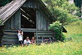 Cyclists on a bike tour having a rest, Carinthia, Austria