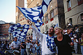 Palio, emotions of the winners, Piazza del Campo, Siena, Tuscany, Italy