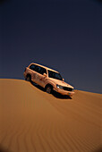 Jeep driving down a sanddune, Desert Tour, Adventure, Al Maha Desert Resort, Dubai, United Arab Emirates