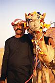 A local man, Bedouin, with camel, Desert, Dubai, United Arab Emirates