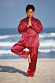 Man doing Tai Chi exercises on the beach, China Beach and Sea, Harmony, Balance, Energy, Meditation, Danang, Vietnam