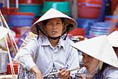 A female vendor, Market, City Scape. Hoi An, Vietnam