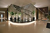 Corridor and spiral staircase, stairs inside Hotel Banyan Tree Spa, Bangkok, Thailand