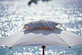 A white sunshade, parasol in front of the sea, Hotel Oberoi, Holiday, Mauritius, Africa
