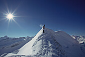 Three snowshoers on mount Nebelhorn, Allgaeu Alps, Bavaria, Germany