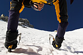 Mountaineer climbing north wall of mount Ortler, Trentino-Alto Adige, Italy