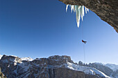 Ice climber rappelling, Langental valley, Dolomites, Trentino-Alto Adige, Italy