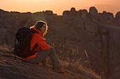 A female hiker having a rest in Andringitra National Park, Madagascar, Africa