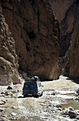 local bus transportation on road through Todra canyon, Morocco