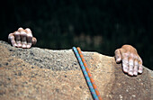 climbers hands and rope at cliff, Yosemite Valley, Yosemite National Parc, California, US