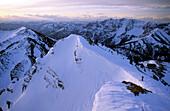 backcountry skier at top of steep Rotwandrinne, Rotwand, Bavarian alps, Upper Bavaria, Bavaria, Germany