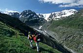 couple of mountaineerers on trail above glacier Gepatschferner, Ötztal range, Tyrol, Austria