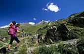 Femal hiker on the way to the Oelgrubenjoch summit, Ötztal Alps, Tyrol, Austria