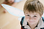 Boy (3-4 years) wearing butterfly wings
