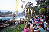 People at the restaurant Riverside on the Mae Nam Ping river in the evening, Chiang Mai, Thailand, Asia