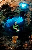 Scuba diver examines ship wreck Liberty, Indonesia, Bali, Tulamben, Indian Ocean