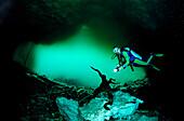 Scuba diver in underwater cave Laguna Pepe, Punta Cana, Freshwater, Dominican Republic