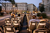 Tourists on the upper deck of a sightseeing bus, Rome, Italy