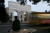 Ancient roman arch, Porta Maggiore Gate, with tram, Rome, Italy