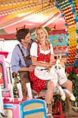 Couple on a fairground ride