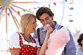 Couple eating pink cotton candy