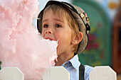 Boy (3-4 years) eating cotton candy