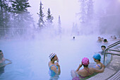 People relaxing in Banff hot springs, Banff, Cascade Mountain, Alberta, Canada