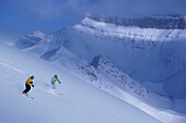 Two skiers in deep snow, Lake Louise, Alberta, Canada