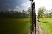 View from a window of an excursion train, Rhoen-Zuegle between Fladungen and Ostheim, Rhoen, Bavaria, Germany