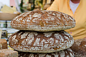 Freshly baked rye bread at a garden festival at Fasanerie Castle near Fulda, Hesse, Germany