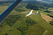 Aerial photo of a glider airplane over the Rhoen Region, Near Wasserkuppe Mountain, Rhoen, Hesse, Germany