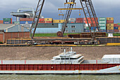 Trawler with opened loading hatch being at container harbour, Duisburg, North Rhine-Westphalia, Germany