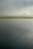 Airplane landing, Duesseldorf, North Rhine-Westphalia, Germany