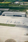 Five airplanes parking in a row at the airport, Munich, Bavaria, Germany