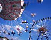 Chairoplane and ferris wheel, Oktoberfest, Munich, Bavaria, Germany