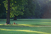 Man sunbathing in English Garden, Munich, Bavaria, Germany