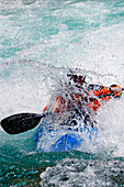 A man is kayaking in wildwater, Boca, Triglav Nationalpark, Slovenia