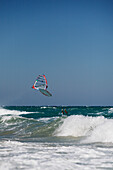 Windsurfer jumping over waves, falling into water, Kos Island, Dodecanese, Greece