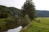 Horseback rider riding along the river Fraenkische Saale, near Bad Kissingen, Rhoen, Bavaria, Germany