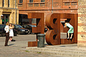 Three women taking photographs at a love sign, Kulturbrauerei, Berlin, Germany