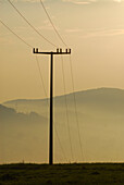 Pylon and morning haze at Hoerselberge, Thuringia, Germany
