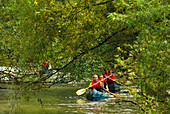 People in a canoe on the Werra river near Breitungen, Thuringia, Germany