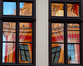 Reflection of city hall in windows, Gotha, Thuringia, Germany