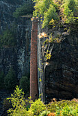 Disused slate mine, out of use, with old chimney, Lehesten, Thuringia, Germany